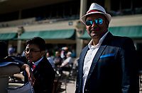 HALLANDALE BEACH, FL - JANUARY 27: A man and his son read the racing program and watch the races together on Pegasus World Cup Invitational Day at Gulfstream Park Race Track on January 27, 2018 in Hallandale Beach, Florida. (Photo by Scott Serio/Eclipse Sportswire/Getty Images)