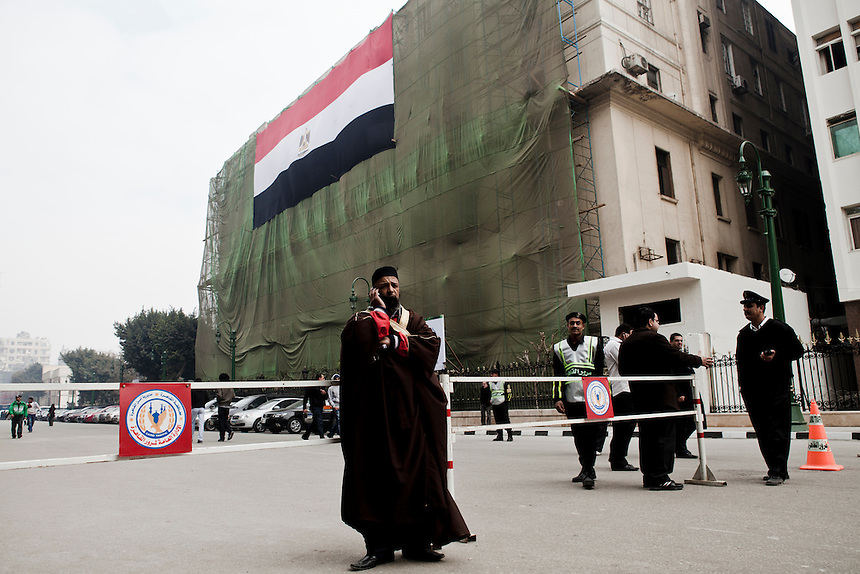 An Egyptian cleric speaks on the phone during protests to mark the opening of the Egyptian Parliament in downtown Cairo, January 23, 2012. Photo: Ed Giles.