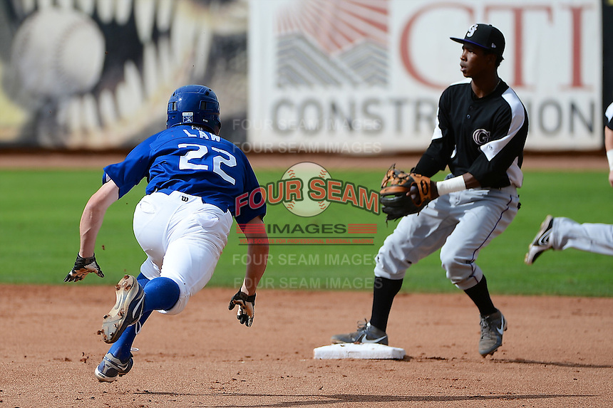 Adam Law (22) of the Ogden Raptors starts a slide into second base against the Grand Junction Rockies while Rockies second baseman Cesar Galvez (2) waits for the throw in Pioneer League play at Lindquist Field on September 8, 2013 in Ogden Utah.  (Stephen Smith/Four Seam Images)