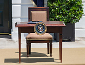 """Empty desk to be used by United States President Donald J. Trump to sign the presidential proclamation titled """"Maximizing Use of American-Made Goods, Products and Materials"""" as he hosts the Third Annual """"Made in America"""" Product Showcase on the South Lawn of the White House in Washington, DC on Monday, July 15, 2019.<br /> Credit: Ron Sachs / CNP"""