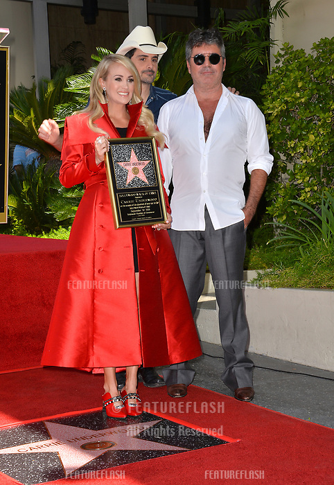 LOS ANGELES, CA. September 20, 2018: Carrie Underwood, Brad Paisley & Simon Cowell at the Hollywood Walk of Fame Star Ceremony honoring singer Carrie Underwood.<br /> Pictures: Paul Smith/Featureflash