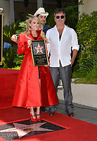 LOS ANGELES, CA. September 20, 2018: Carrie Underwood, Brad Paisley &amp; Simon Cowell at the Hollywood Walk of Fame Star Ceremony honoring singer Carrie Underwood.<br /> Pictures: Paul Smith/Featureflash