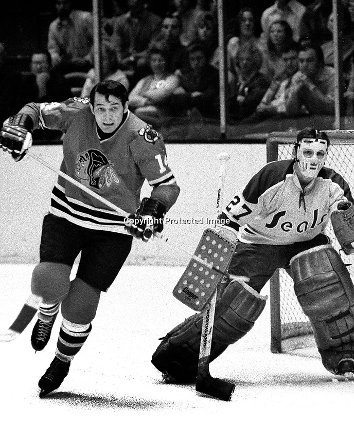 Seals vs Black Hawks 1971, goalie Gilles Melloche and .Hawks Bryan Campbell.  (photo/Ron Riesterer)