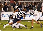 November 12, 2011:Nevada Wolf Pack receiver Rishard Matthews fights for extra yardage during a WAC league game vs Hawaii played at Mackay Stadium in Reno, Nevada.
