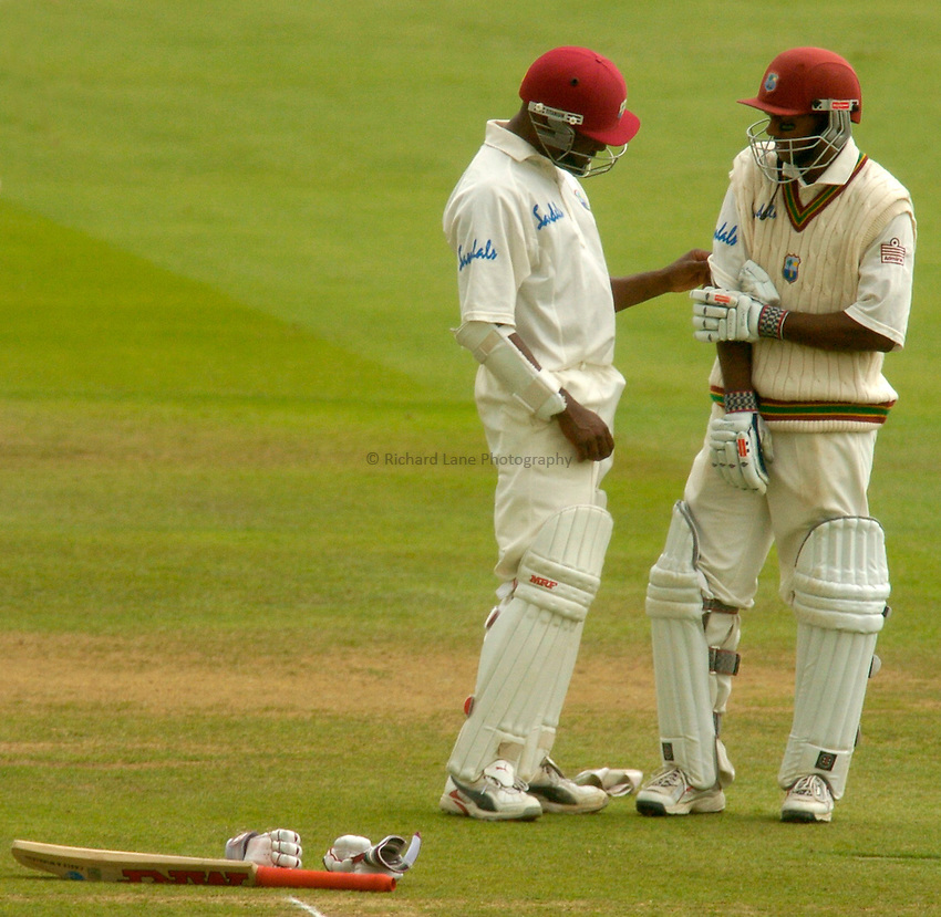 Photo. Glyn Thomas. .England v West Indies. First Test, nPower Test Series..Day 5. 26/07/2004..Brian Lara (L) checks to see Shivnarine Chanderpaul is alright after being struck on the elbow by a delivery from Matthew Hoggard.