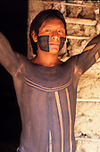 Catete, Xingu, Brazil. Young Xicrin Kayapo man with full face and body paint.