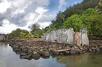 Marae Ovarua, a stone courtyard with platform and standing stones, built by a Polynesian civilisation and used as a ceremonial and religious site, on the banks of Lake Fauna Nui or Maeva Lake, at the archaeological site at Maeva village, on Huahine-Nui on the island of Huahine, in the Leeward Islands, part of the Society Islands, in French Polynesia. The marae were used for worshipping ancestors and gods, and offerings were made here. The marae are thought to date from 13th - 15th centuries. Maeva is thought to be an abandoned royal settlement, with many megalithic structures including marae, houses, agricultural structures, stone fish traps and fortification walls. Picture by Manuel Cohen