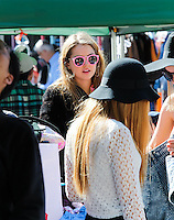 Isabelle Cornish working her Clothes Stall at Glebe Markets