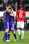 Manchester United's Paul Pogba walks off dejected as Anderlecht's Youri Tielemans and Anderlecht's Leander Dendoncker celebrate during the Europa League Quarter Final 1st leg match at RSCA Constant Vanden Stock Stadium, Anderlecht, Belgium. Picture date: April 13th, 2017.Pic credit should read: Charlie Forgham-Bailey/Sportimage