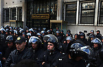 Police somberly watched demonstrators while guarding the Interior Ministry Interior Ministry in downtown Tunis, Tunisia, Jan. 14, 2011. Several thousand people gathered outside the Ministry to protest and ask President Zine El Abidine Ben Ali to resign.