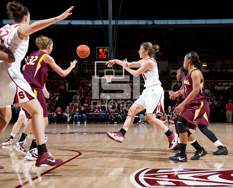 STANFORD, CA - January 8, 2011: Toni Kokenis of the Stanford Cardinal women's basketball team passes during Stanford's game against Arizona State at Maples Pavilion. Stanford won 82-35.