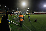 Groundstaff dismantling the goals after the Boxing Day derby match between Runcorn Town and visitors Runcorn Linnets at the Pavilions, Runcorn, in a top-of the table North West Counties League premier division match. Runcorn Linnets won 1-0 and overtook their neighbours at the top of the league in a game watched by 803 spectators. Runcorn Linnets were a successor club to Runcorn FC, one of England foremost non-League clubs of the 1970s and 1980s.
