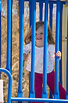 Toddler with playground equipment.
