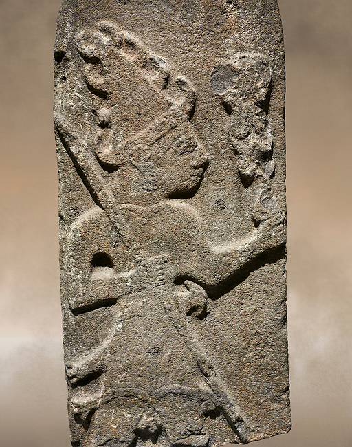 Hittite monumental relief sculpture ofa God probably holding lightning rods. Late Hittite Period - 900-700 BC. Adana Archaeology Museum, Turkey.