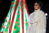 First lady Melania Trump listens as President Donald Trump speaks during the 2018 National Christmas Tree Lighting Ceremony at the Ellipse near the White House on November 28, 2018 in Washington, DC. (Photo by Oliver Contreras/SIPA USA)<br /> Credit: Oliver Contreras / Pool via CNP
