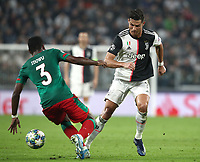 Football Soccer: UEFA Champions League -Group Stage-  Group D - Juventus vs Lokomotiv Moskva, Allianz Stadium. Turin, Italy, October 22, 2019.<br /> Juventus' Cristiano Ronaldo (r) in action with Locomotiv Moskva's Bryan Idowu (l) during the Uefa Champions League football soccer match between Juventus and Lokomotiv Moskva at Allianz Stadium in Turin, on October 22, 2019.<br /> UPDATE IMAGES PRESS