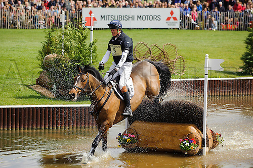 05.05.2013 Badminton, England. William Fox-Pitt on Oslo tackles 'The Lake' water jump during the Cross Country Test of the Mitsubishi Motors Badminton Horse Trials 2013 in the grounds of Badminton House.