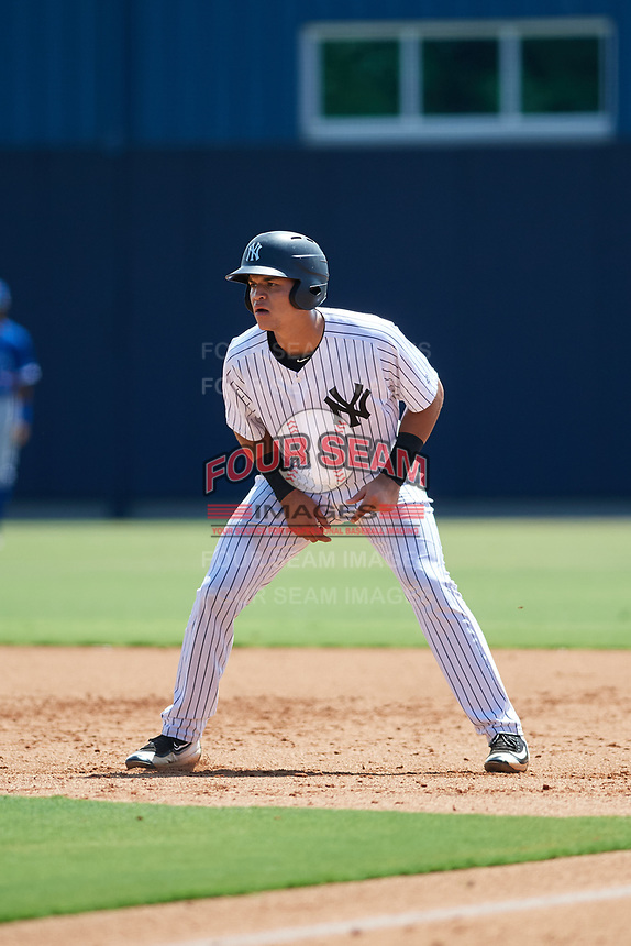 GCL Yankees East catcher Pedro Diaz (55) leads off first base during a game against the GCL Blue Jays on August 2, 2018 at Yankee Complex in Tampa, Florida.  GCL Yankees East defeated GCL Blue Jays 5-4.  (Mike Janes/Four Seam Images)