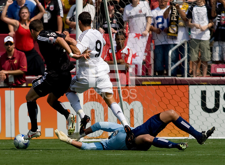 DC United goalkeeper (31) Josh Wicks pushes the ball away from Real Madrid forward (9) Cristiano Ronaldo as DC United's (4) March Burch defends during their friendly at FedEx Field in Landover, Maryland.  Real Madrid defeated DC United, 3-0.