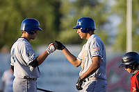 July 7, 2009: Tri-City Dust Devils' Jeremiah Sammy (right) gets a knuckle bump from Kent Matthes (left) after hitting a home run during a Northwest League game against the Salem-Keizer Volcanoes at Volcanones Stadium in Salem, Oregon.