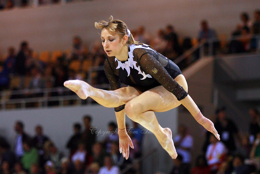Oct 17, 2006; Aarhus, Denmark; Marina Proskurina of Ukraine performs cossack jump on balance beam during women's gymnastics team competition at 2006 World Championships Artistic Gymnastics.