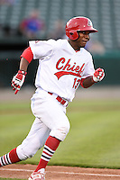 Peoria Chiefs outfielder Kenneth Peoples-Walls (13) runs to first during a game against the Kane County Cougars on June 2, 2014 at Dozer Park in Peoria, Illinois.  Peoria defeated Kane County 5-3.  (Mike Janes/Four Seam Images)