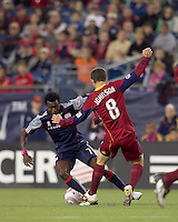 New England Revolution midfielder Kenny Mansally (7) attempts to dribble by Real Salt Lake midfielder Will Johnson (8). Real Salt Lake defeated the New England Revolution, 2-1, at Gillette Stadium on October 2, 2010.
