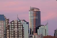 Vancouver area of Burrard bridge showing apartment, office blocks marina  at dusk. bridge British Columbia, Canada