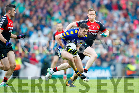 Paul Geaney Kerry in action against Brendan Harrison and Donal Vaughan Mayo in the All Ireland Semi Final in Croke Park on Sunday.