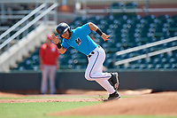 Miami Marlins J.D. Orr (9) attempts to steal second base during an Instructional League game against the Washington Nationals on September 25, 2019 at Roger Dean Chevrolet Stadium in Jupiter, Florida.  (Mike Janes/Four Seam Images)