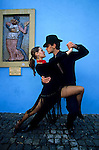 Mariana and Pablo dance tango at Caminito St. in the popular neighbourhood of La Boca, in Buenos Aires May 18, 2003. Carlos Gardel, the biggest start of tango from all times dedicated a song to this street. Today craftsmen, painters, dancers and musicians, give to this typical street a colourful life of tango. Photo by Quique Kierszenbaum