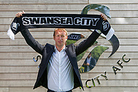 Pictured: Graham Potter holds a club scarf. Monday 11 June 2018<br /> Re: Graham Potter is announced as the new manager for Swansea City AFC at the Fairwood Training Ground, south Wales, UK.