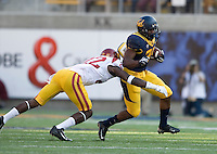 Jeffrey Coprich of California runs the ball during NCAA football game against USC at Memorial Stadium in Berkeley, California on November 9th, 2013.   USC defeated California, 62-28.