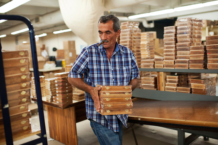 UNITED STATES - AUGUST 21:  Osmani Calero stacks boxes of cigars at Padrón Cigars in the Little Havana section of Miami, Fla.  Some of the boxes are bound for the Republican National Convention in Tampa.  (Photo By Tom Williams/CQ Roll Call)
