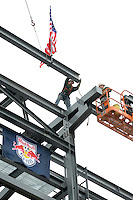 Workers place the last piece of steel during the topping off ceremony at Red Bull Arena in Harrison, NJ, on April 14, 2009.