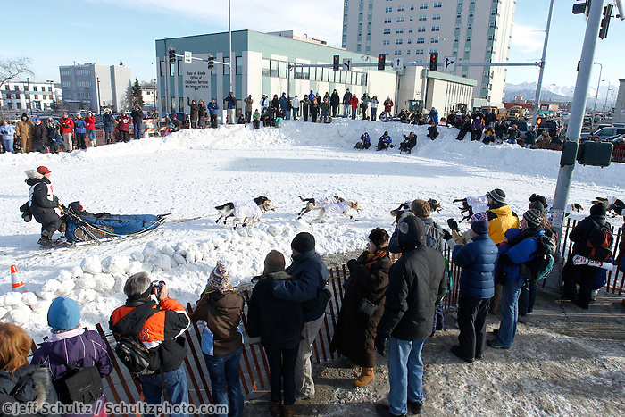 Kelley Griggin makes the turn at Cordova Street and 4th avenue in downtown Anchorage, Alaska during the ceremonial start of the 2011 Iditarod