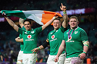 Joey Carbery, Andrew Porter and Tadhg Furlong celebrate after the match. Natwest 6 Nations match between England and Ireland on March 17, 2018 at Twickenham Stadium in London, England. Photo by: Patrick Khachfe / Onside Images