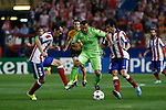 Atletico de Madrid´s Diego Godin (L) and Tiago Cardoso and Juventus´s Carlos Tevez (C) during Champions League soccer match between Atletico de Madrid and Juventus at Vicente Calderon stadium in Madrid, Spain. October 01, 2014. (ALTERPHOTOS/Victor Blanco)