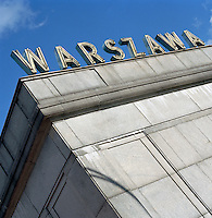 """Warsaw"" sign on top of a building in Warsaw, Poland"