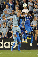 Aurelien Collin (78) defender Sporting KC goes up for a header with Matteo Ferrari and Hassoun Camara ..Sporting Kansas City defeated Montreal Impact 2-0 at Sporting Park, Kansas City, Kansas.