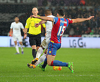 Mile Jedinak of Crystal Palace (R) fouls Wayne Routledge of Swansea during the Barclays Premier League match between Swansea City and Crystal Palace at the Liberty Stadium, Swansea on February 06 2016