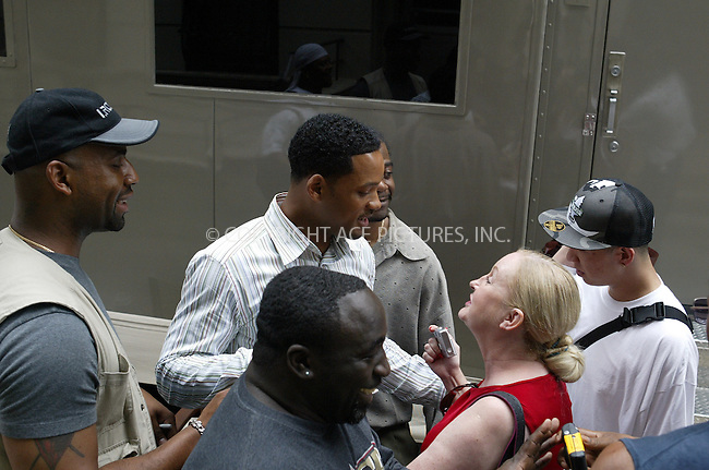 Mr. Nice Guy Will Smith takes good care of his fans as he walks around on the set of 'Last First Kiss' with his bodyguards. New York, June 10, 2004. Please byline: PHILIP VAUGHAN/ACE Pictures.   .. *** ***  ..All Celebrity Entertainment, Inc:  ..contact: Alecsey Boldeskul (646) 267-6913 ..Philip Vaughan (646) 769-0430..e-mail: info@nyphotopress.com