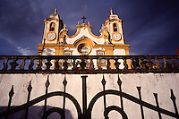 """The parish church of Santo Antonio (circumflex over the o in Antonio) stands atop a hill in Tiradents, Brazil. The facade of the church features a relief by Brazil's baroque master sculptor and architect Antonio (circumlex over the o) Francisco Lisboa, also known as """"Aleijadinho,"""" (cq) or the little cripple, because of a severe case of leprosy. Brazil's interior state of Minas Gerais, once a colonial mining capitol for the Portuguese crown, has changed little in appearance since the 18th century. With the help of laws to preserve its baroque architecture, the state's sky is scraped at every turn by 250-year-old church steeples, and lined with cobblestones. (Kevin Moloney for the New York Times)"""