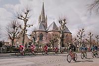 peloton coming through town<br /> <br /> Driedaagse Brugge-De Panne 2018<br /> Bruges - De Panne (202km)