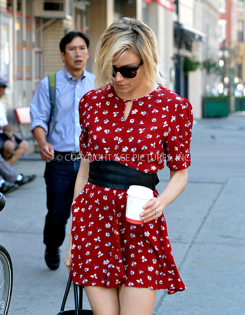 WWW.ACEPIXS.COM<br /> <br /> May 4 2015, New York City<br /> <br /> Actress Sienna Miller walks in the West Village on May 4 2015 in New York City<br /> <br /> By Line: Curtis Means/ACE Pictures<br /> <br /> <br /> ACE Pictures, Inc.<br /> tel: 646 769 0430<br /> Email: info@acepixs.com<br /> www.acepixs.com