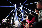 JOHANNESBURG, SOUTH AFRICA - FEBRUARY 19: A model walks for the designer David Tlale on the Nelson Mandela Bridge at the Joburg Fashion Week on February 19, 2011, in Johannesburg, South Africa. David Tlale, is an award winning designer and one of South Africa's finest designers, dressing celebrities and others in couture with elegance and high quality material. He held his show at the Mandela Bridge in downtown Johannesburg. A logistical nightmare, the bridge was closed and turned into a catwalk at midnight with hundreds of people watching the show. 92 models, one for each of Nelson Mandela's years walked the 285 meter bridge, maybe the longest catwalk in the world. South African top designers with showed their 2011 Autumn & Winter collections during the 5 day event. (Photo by Per-Anders Pettersson