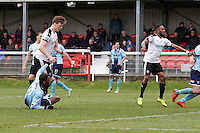 Omar Boggles of Grimsby Town (right) watches his effort go wide during the Vanarama National League match between Dover Athletic and Grimsby Town at the Crabble Athletic Ground, Dover, England on 16 April 2016. Photo by Tony Fowles.