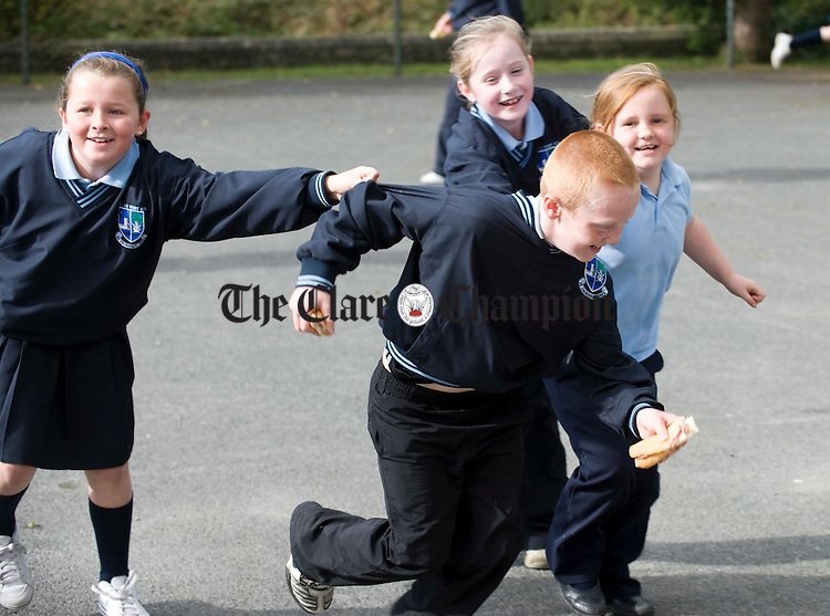 Ryan Casey is caught by Allanah Killoughery, Megan Clancy and Ashley O Brien at Kildysart NS. Photograph by John Kelly.