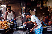 Vendors prepare sweets at a street stall in the New Market area of Kolkata, India, on Saturday, May 27, 2017. Photographer: Sanjit Das
