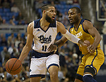 Nevada forward Cody Martin (11) is guarded by California Baptist guard Milan Acquaah (0) in the first half of an NCAA college basketball game in Reno, Nev., Friday, Nov. 16, 2018. (AP Photo/Tom R. Smedes)